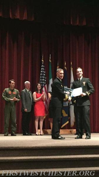 Firefighter Ryan Litchert receiving his officer's commission in the United States Navy.