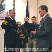 Chief Jonathan Stafford being sworn in as Chief of the Department.